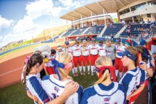 Family — The Lady Flames huddled up before their game against Charleston Southern.Photo credit: Leah Seavers