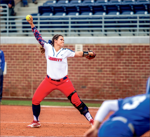 bring it — Pitcher Chandler Ball delivers a pitch during the Lady Flames 7-5 loss in the first game against Hampton. Photo credit: Leah Seavers