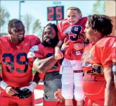 inspiration — Nathan Norman, an honorary Flame who has battled cancer since he was two, scored the spring game's opening touchdown. Photo credit: Michela Diddle