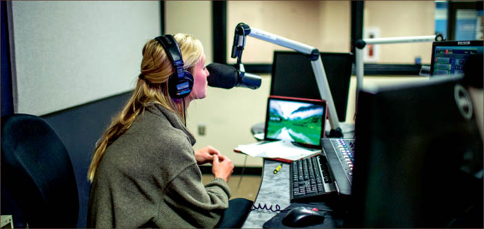 on the air — 90.9 The Light, a station certified by the Federal Communications Commission, offers hands-on experience to students looking for experience in radio. Photo credit: Leah Seavers