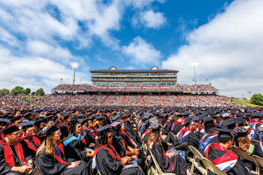 Celebrate — Graduates and families filled Williams Stadium for commencement May 2015. Photo credit: James Hancock|
