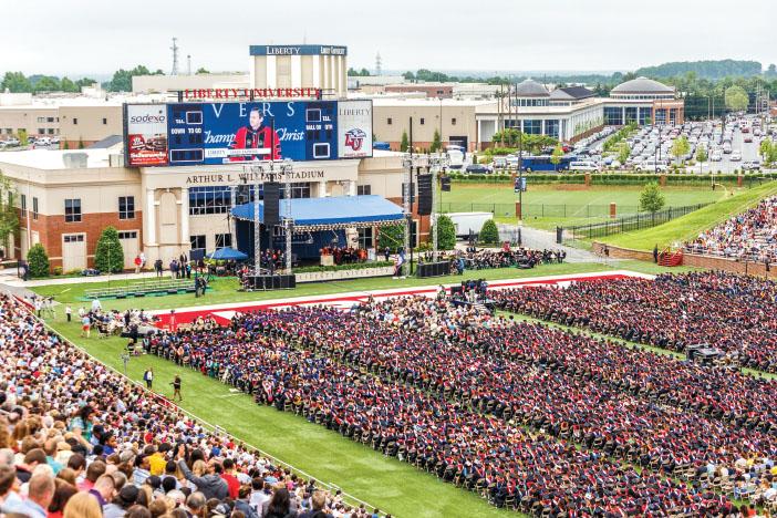 STADIUM — President Jerry Falwell opened the 2015 commencement ceremony before former Florida Gov. Jeb Bush addressed the crowd of graduates. Photo credit: James Hancock
