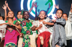 SING ALONG — The Children of the World International Choir, composed of chilren from Nepal, Honduras, Uganda, India and the Philippines, performed multiple songs on-stage during Convocation Sept. 14. to kick off Global Focus Week. Photo credit: Michela DiDDle
