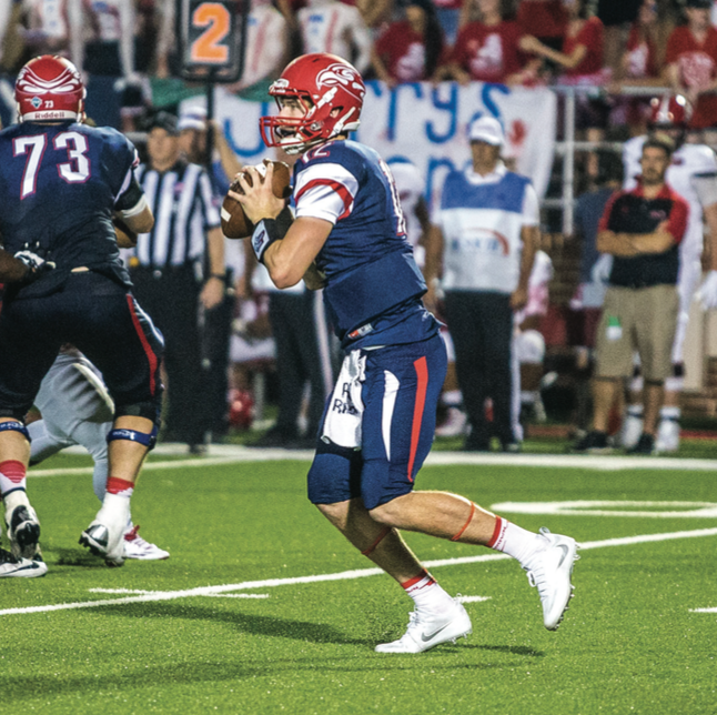 QUARTERBACK WOES — Buckshot Calvert came in to replace starting quarterback Stephon Masha during the first half. Photo credit: Michela Diddle