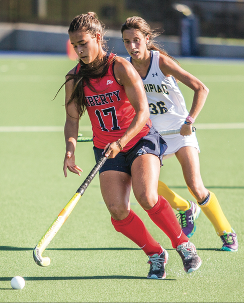 HUSTLE — Flames Agueda Moroni flew past Quinnipiac forward Ines Ruiz Martinez. Photo credit: Caroline SellerS