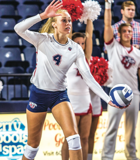 FRESHMAN — Casey Goodwin prepares to serve in a Flames matchup earlier this year. Photo credit: Caroline Sellers