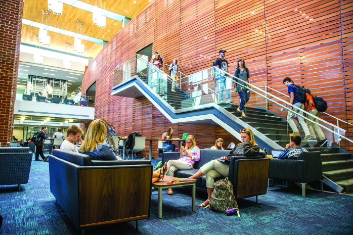 LOUNGE — Students study and socialize at the new Montview Student Union located in central campus. Photo credit: Michela Diddle