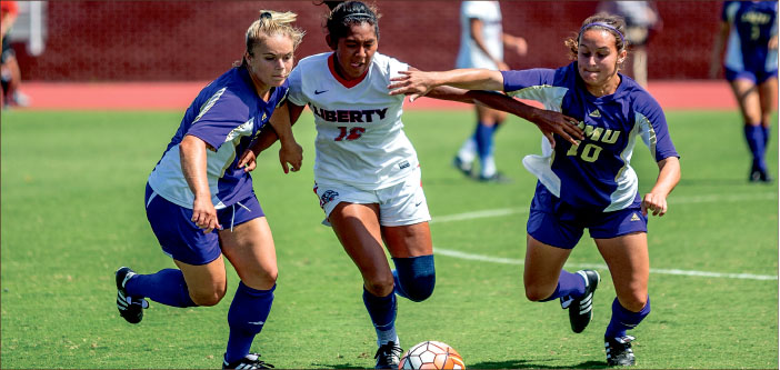 BATTLE — Redshirt junior midfielder Bertha Martinez jockeyed for position against two James Madison players during their 1-0 victory, marking the program's first-ever win over JMU. Photo credit: Michela Diddle
