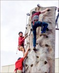RISING ABOVE — Students climbed a rock wall outside of the LaHaye Ice Center.  Photo credit: Dean Hinnant