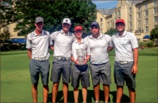 WINNER — Kieran Vincent shows off his first-place trophy with the rest of the golf team. Photo credit: Jeff Thomas