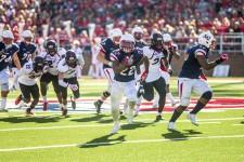 SCREEN — Junior running back Todd Macon caught a pass from freshman quarterback Buckshot Calvert and ran for a 40-yard gain. Photo credit: Michela Diddle