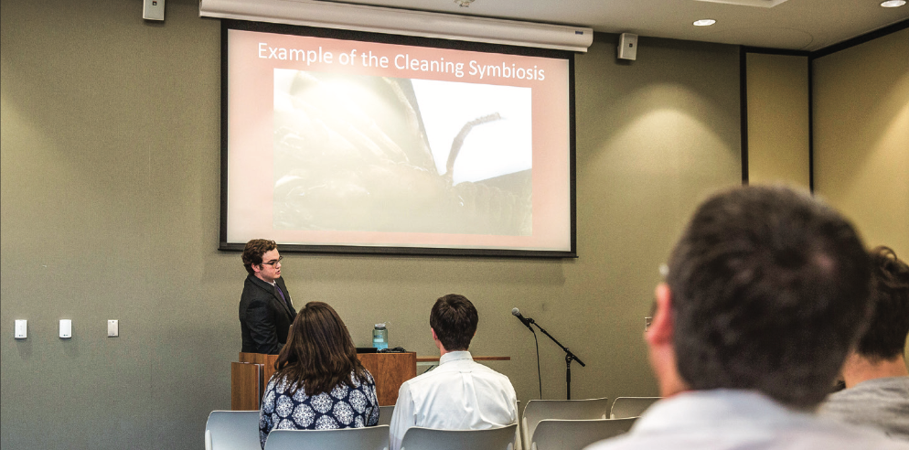 LEARN — Student Benjamin Groski presented his research  ndings in March 2016 to a crowd in the Jerry Falwell Library. Research symposiums are held regularly at the library. Photo credit: Jessie Rogers