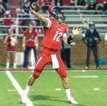 SHOTGUN — Buckshot Calvert threw for 340 yards and four touchdowns against Robert Morris in his first career start. Photo credit: Michela Diddle