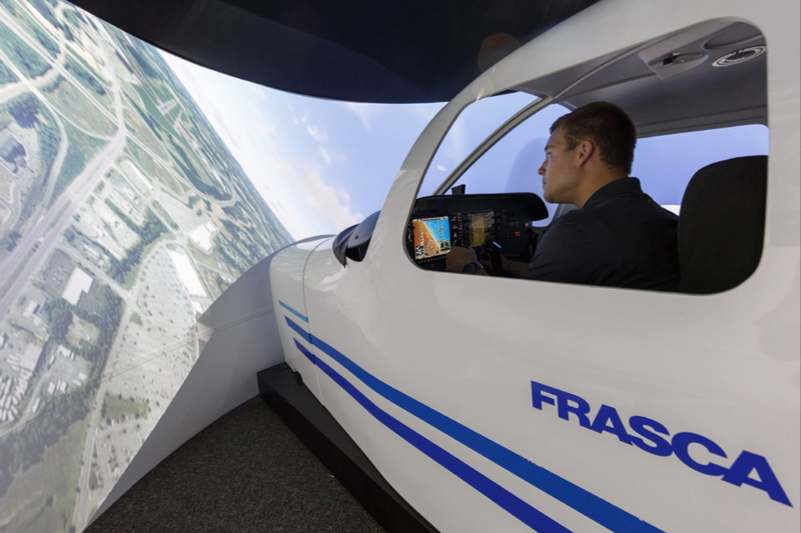 NEXT BEST THING  — Aviation students practiced flying in a simulator to log their required flight hours mandated by the school of aviation. Photo credit: Joel Coleman