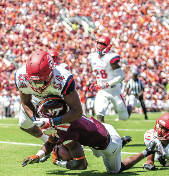 HIT — Juwan Wells tackled a Virginia Tech player. Photo credit: Michela Diddle