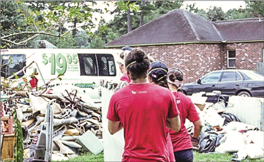 RELIEF — Liberty students partnered with groups in Louisiana to haul away damaged property from houses. Photo Provided
