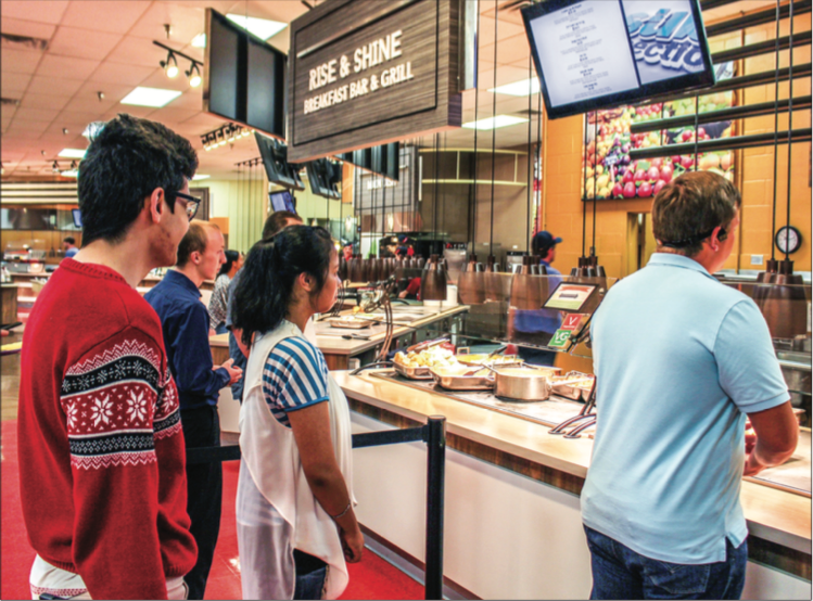 HOT N' READY — Students waited in line to order a meal from the Rise & Shine Breakfast Bar & Grill at the Reber Thomas Dining Hall. Photo Credit: Christianne Gormley