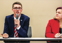 Liberty Champion represent— Donald Trump supporter Josh Rosene (left) and Jill Stein supporter Allie Childers (right) lobbied for their respective candidates' stances on a variety of issues.  Photo Credit: Zenny Phuong