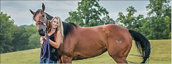 HORSING AROUND — Josie McCormick poses with her horse. McCormick has been ranked No. 8 in the world at the National Barrel Horse Association World Championships.  Photo Provided