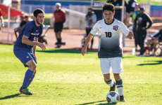 KICK — Sophomore midfielder Kevin Mendoza dribbled past a Blue Hose defender. PC: Amber Tiller | Liberty Champion