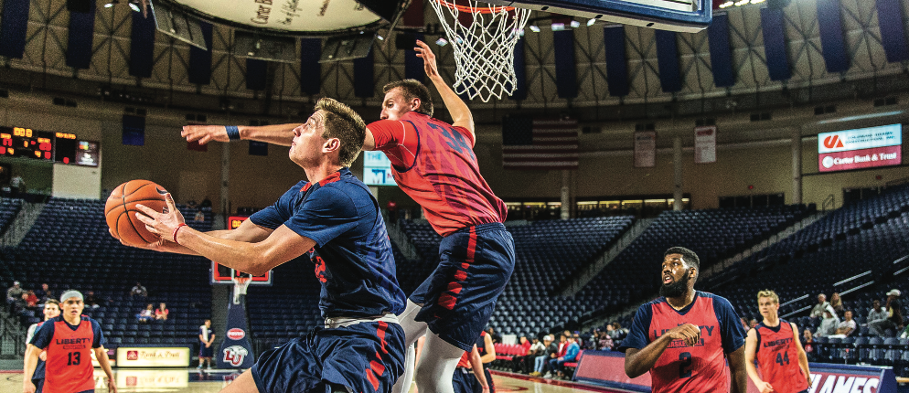 REVERSE — Freshman forward Brock Gardner attempted a reverse layup in the Flames scrimmage in the Vines Center. Photo Credit: Amber Tiller