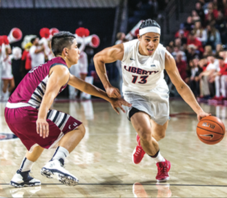 QUICK — Senior guard Ray Chen dribbled past the defense. Michela Diddle | Liberty Champion