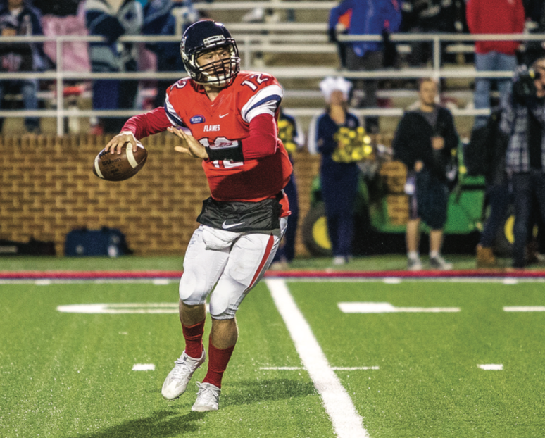 CANNON — Flames quarterback Stephen Calvert threw for 261 yards. Photo credit: Michela Diddle