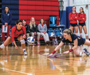 STRETCH — Sophomore libero Margaret Latchford dove for the ball during the game.  Photo credit: Michela Diddle