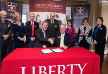 GRATITUDE — Members of the Charles B. Keesee Educational Fund board signed a partnership with Liberty University that will provide grants to graduate residential students in the Rawlings School of Divinity.  Photo Credit: Kaitlyn BecKer