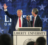 SPEECH — Liberty President Jerry Falwell (right) stood on stage next to President-elect Don- ald Trump as he waved to Liberty students during his visit to Convocation Monday, Jan. 18.  Photo Credit: leah SeaverS