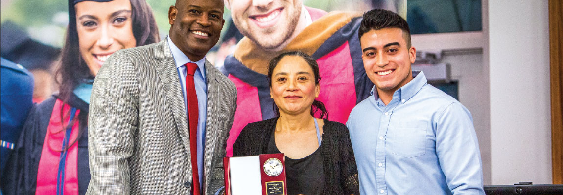 AWARD — Reina Alvarez (middle) was given the Outstanding Parent Award after her son Jesse (right) nominated her. Photo Credit: Kevin Manguiob