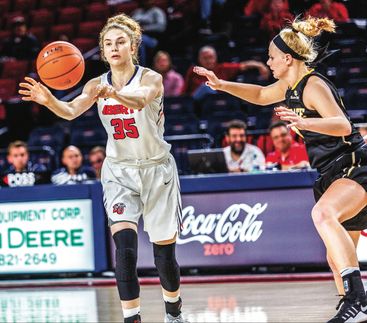 PASS — Freshman forward Ola Makurat dished the ball to a teammate in the front court. Photo credit: Leah Seavers