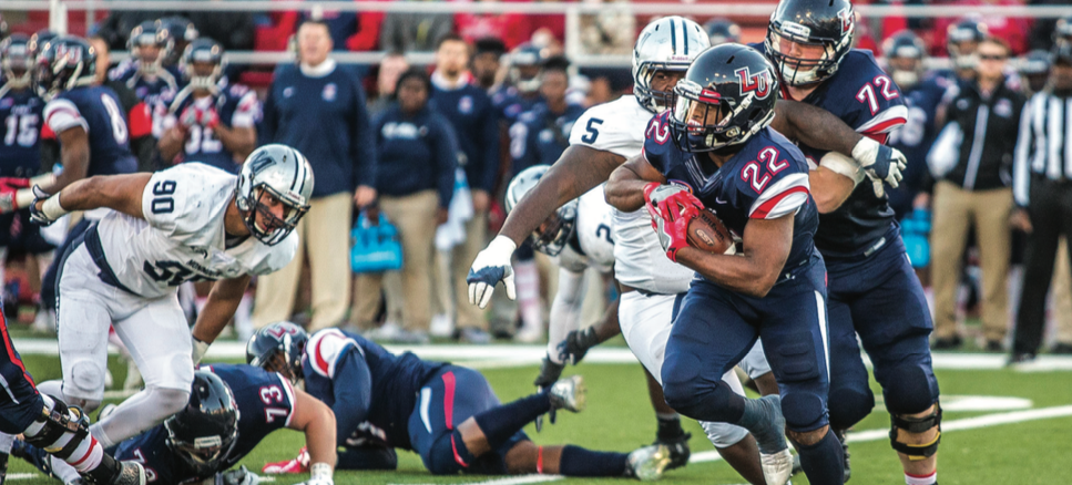 CUTBACK — Junior running back Todd Macon broke an outside run toward the sidelines. Photo credit: Michela Diddle