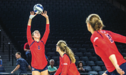 UP, UP AND AWAY — Junior setter Anna Willey set up the ball for teammates Sydney Morris and Sirena Vorster. Photo Credit: Michela Diddle