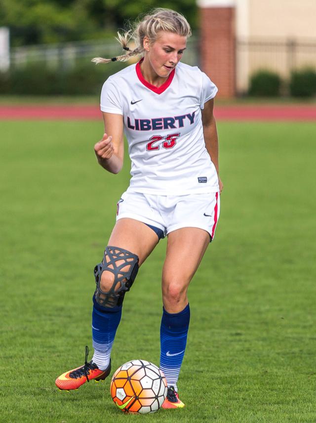 POISE — Freshman defender Elisa Warren delivered a pass. Photo credit: Michela Diddle