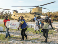 HELPING HAND — USAID Volunteers brought boxes of donations to hurricane refugees in Haiti after it was hit severely by Hurricane Matthew. Photo Credit: Google Images