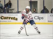 skater — Freshman defenseman Matt Cruickshank moved the puck down the ice.   Photo Credit: Caroline Sellers