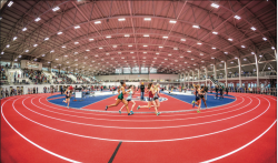 SPRINT — The Flames competed in the new indoor track for the first time this past weekend. Photo Credit: Nathan Spencer