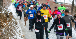 """BUNDLED UP — The Arctic 5k touts the tagline """"ice, sweat and tears,"""" with the 3.1 mile trail elevations reaching more than 1,250 feet. Photo Credit: Leah Seavers"""