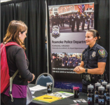 JOBS — Police recruiters came to the Law Enforcement Career Fair Oct. 4. Photo Credit: Kevin Manguiob