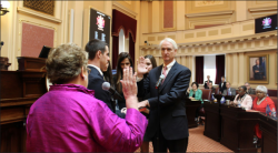 SOLEMNLY SWEAR — Lynchburg attorney Mark Peake took the oath of of office proceeding his election into the Virginia State Senate. Photo Provided