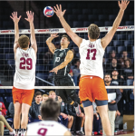 SPIKE — Andrew Eves attempted to hit the ball over two Virginia Tech players in a back row attack. Photo Credit: Michela Diddle