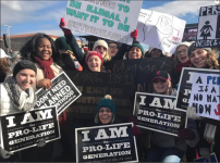 GATHER — March attendees carried signs with phrases for pro-life awareness. Photo Provided
