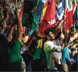 CULTURES — The Parade of Nations included 156 students representing 87 countries. Photo Credit: Michela Diddle