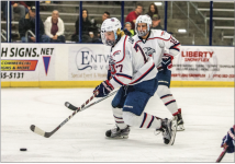 BATTLE — Freshman defender Chaydan Lauber fought for possession of the puck.  Photo Credit: Caroline sellers