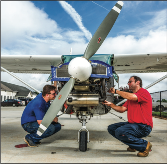 FIXER UPPER — Students also have the opportunity to pursue degrees in aviation maintentance or safety management. Photo Credit: Joel coleMan