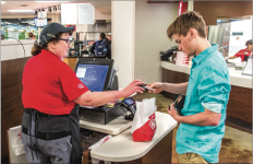 CHA-CHING — Students have commonly used Flames Cash to make purchases at on-campus venues such as Chick- l-A. Photo Credit: Denton Day