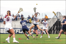LAX — Sophomore attacker Kayla Foster jumped up and launched a pass. Photo Credit: Michela Diddle