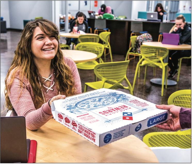 DELISH — JoyRun users can request a delivery to their dorm, of ce or favorite study space. SAUPPE is a feature reporter. KirKland Gee | liberty Champion CONVENIENT — Users pay for their food and delivery through the app with debit or credit. Photo Credit: KirKland Gee