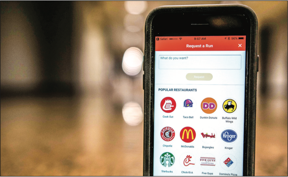 CONVENIENT — Users pay for their food and delivery through the app with debit or credit. Photo Credit :KirKland Gee